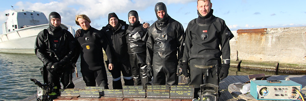 Divers in Estonia displaying their underwater welds.